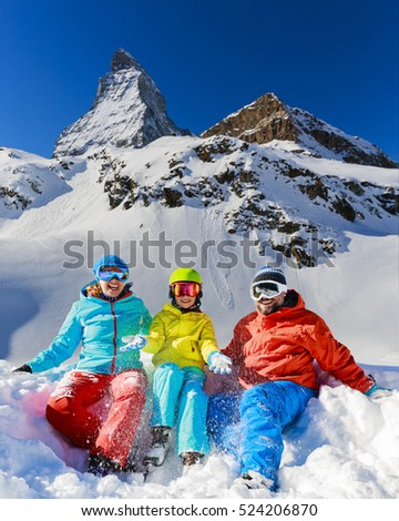 Ski in winter, snow - family enjoying winter vacation in Zermatt, Switzerland