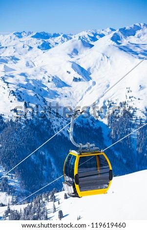 Ski lift chairs on bright winter day. Vertical view - stock photo
