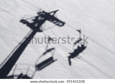 Ski lift chairs on winter day over the clouds, - stock photo