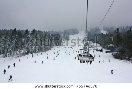 Ski lift in a ski resort on a cloudy day