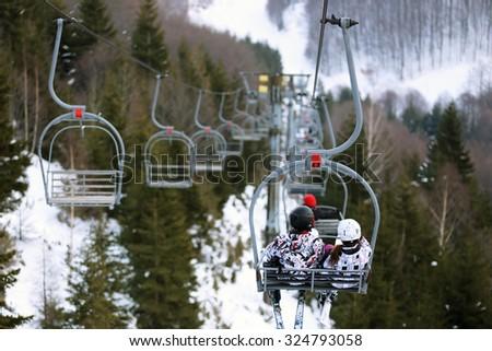 ski lift in ski resort in winter - stock photo