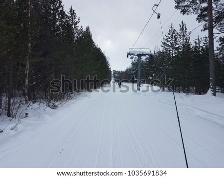 ski-lift in Sweden, draging through a forest area