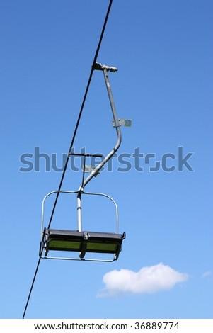 ski lift on blue sky background - stock photo
