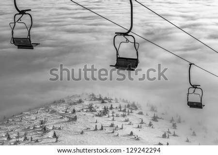 Ski lift on bright winter day - stock photo