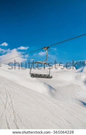 Ski lifts during bright winter day