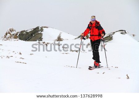 Ski mountaineer climbing a mountain in bad weather