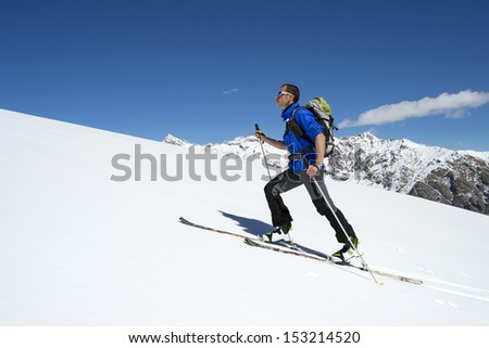 Ski mountaineering cross country skiing in Italian Alps - stock photo
