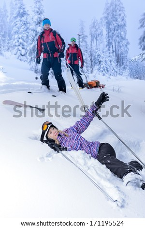 Ski patrol rescue injured woman after accident lying in snow - stock photo