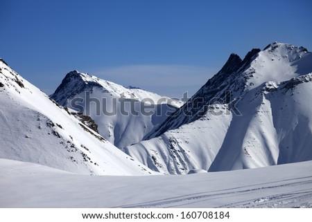 Ski piste at nice winter day. Caucasus Mountains, Georgia, ski resort Gudauri. - stock photo