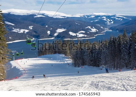 Ski Resort above a lake. View from the slope