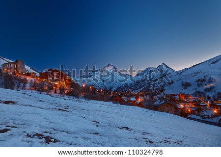 Ski resort in French Alps at night - stock photo
