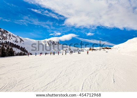 Ski resort in the Alps. Panoramic view of the mountains. People skiing and snowboarding. Mayerhofen, Austria - stock photo