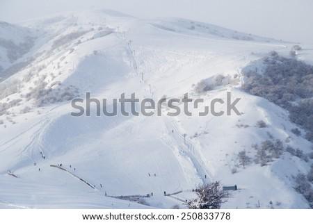 ski resort in the mountains in winter - stock photo