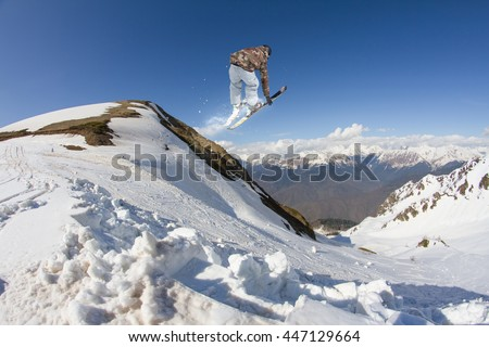 Ski rider jumping on mountains. Extreme ski freeride sport. - stock photo