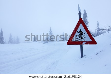 Ski sign at road side on foggy winter day in Norwegian highland area - stock photo