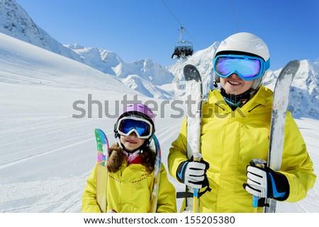 Ski, ski resort, winter sports - family on ski vacation - stock photo