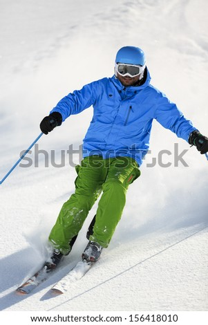 Ski, Skier, Freeride in fresh powder snow - man skiing downhill - stock photo