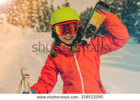 Ski, skier girl enjoying winter vacation - stock photo