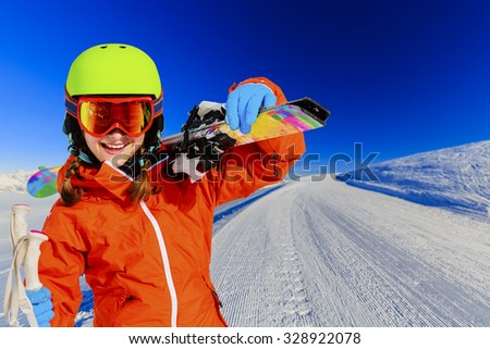 Ski, skier girl on ski run - stock photo