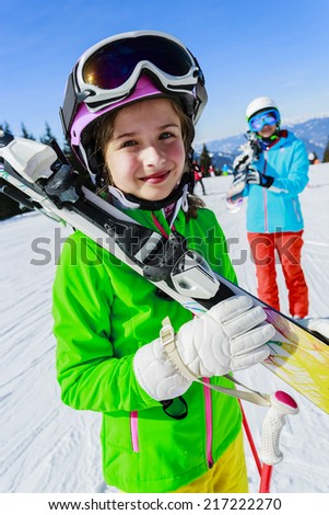 Ski, skier, snow and fun - girl enjoying winter vacations - stock photo