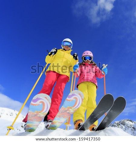 Ski, skier, sun and winter fun - skiers enjoying ski vacation - stock photo