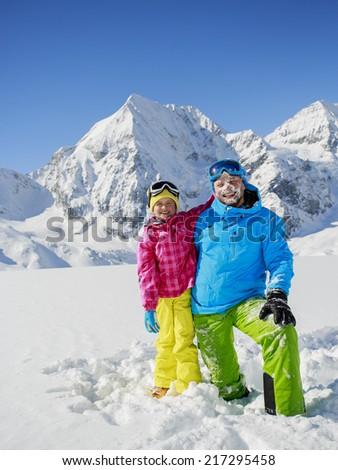 Ski, skier, sun and winter fun - skiers enjoying winter vacations - stock photo