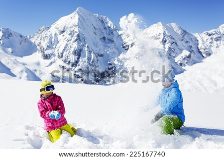 Ski, skier, sun and winter fun - skiers enjoying winter vacations - stock photo