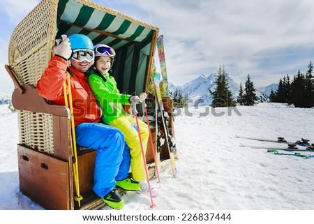 Ski, skier, sun - family enjoying winter vacations - stock photo