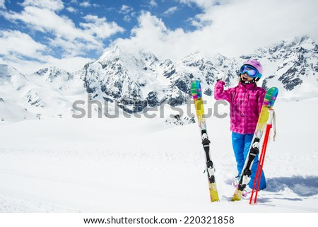 Ski, skier, winter - lovely girl enjoying winter vacation - stock photo