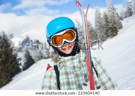 Ski, skier, winter - portrait of lovely girl has a fun on ski - stock photo