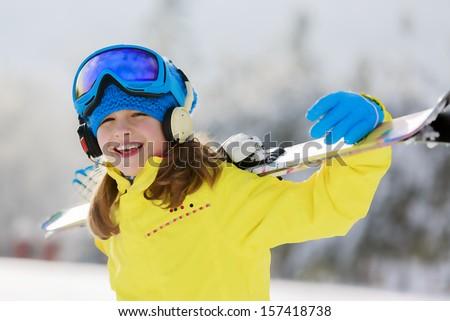 Ski, skier, winter sports - portrait of happy young skier - stock photo