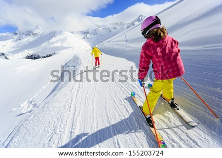 Ski, skiers on ski run - child skiing downhill - stock photo