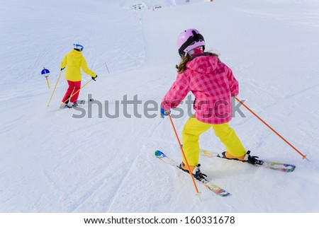 Ski, skiers on ski run - female skiers skiing downhill,  child on ski lesson - stock photo
