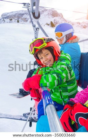 Ski, skiing - Little skier boy on ski lift - stock photo