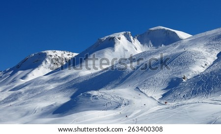 Ski slope and mountain - stock photo