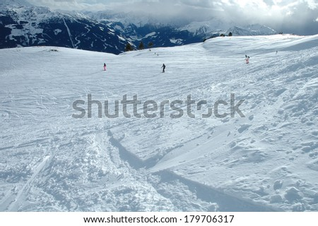 Ski slope and skiers in Austria nearby Kaltenbach in Zillertal valley