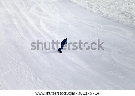 Ski slope and snowboarder at sun day. Georgia, ski resort Gudauri. Caucasus Mountains. - stock photo