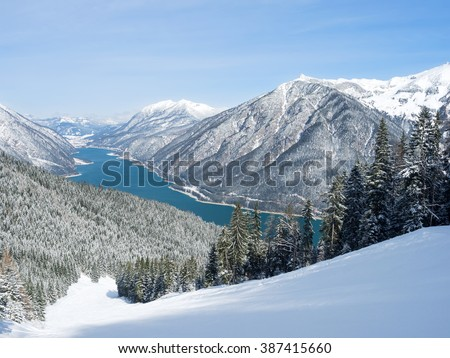 Ski-slope at Lake Achensee with snow-covered trees, Pertisau, Tyrol, Austria - stock photo
