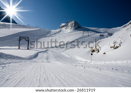 Ski slope under high mountains. Kaprun, Austria. - stock photo