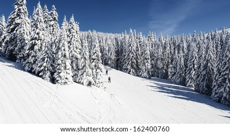 Ski Slope with a beautiful Winter Panorama - stock photo