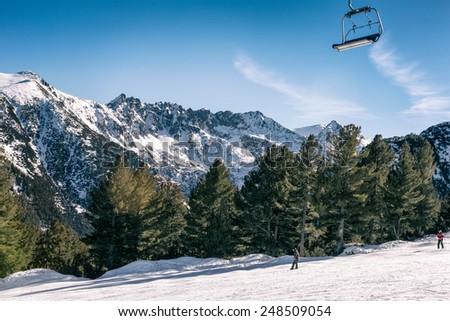 Ski slope with chair lift and winter mountains panorama., resort Bansko, Bulgaria  - stock photo