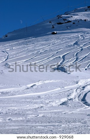 Ski slope with moon.