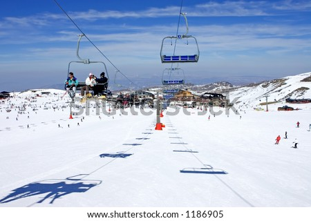 Ski slopes and chair lifts of Pradollano ski resort in the Sierra Nevada mountains in Spain - stock photo