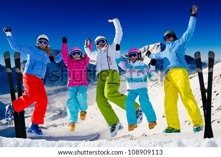 Ski, snow  and winter fun - happy family ski team