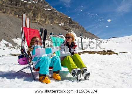 Ski, snow, sun and winter holidays - skiers in Dolomites - stock photo