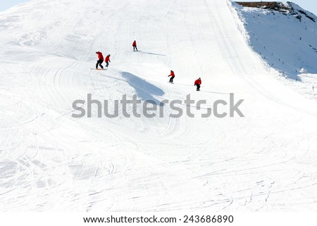 Ski traces. Five Snowboarders. High-speed descent from snow-covered mountain slope on Snowboard. - stock photo
