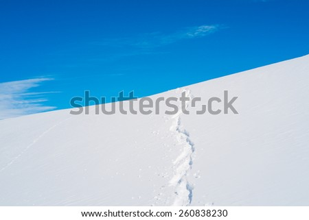Ski track on the snow in Alps moutnains, Val Thorens, France - stock photo