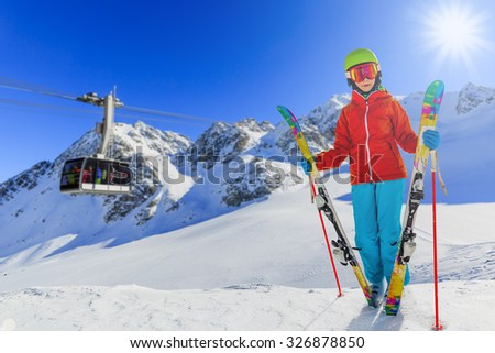 Ski vacation, snow, skier girl enjoying winter - stock photo