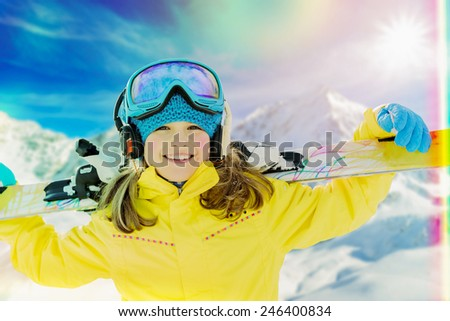 Ski vacation, snow, skier, sun and fun - girl enjoying winter vacations, filtered - stock photo