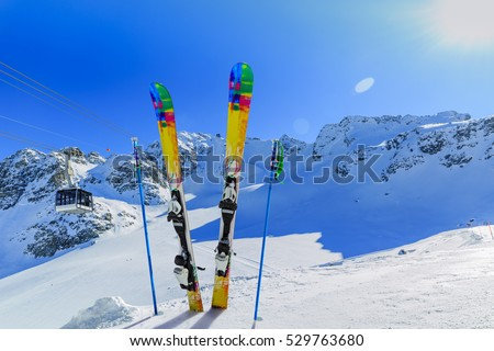Ski winter season - mountains, cable car and ski equipments on ski run